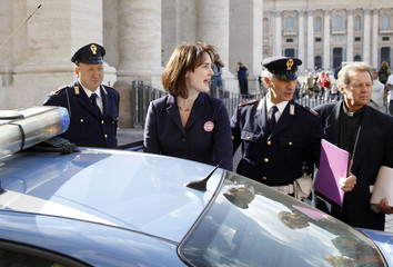 Father Bougeois from Georgia and Miriam Duignan of the U.S. prepare to enter in a police car after a protest with a group of Roman Catholic activist in front of the Vatican