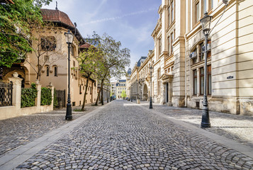 The beautiful Strada Postei street in the Lipscani district, in a moment of tranquility without people, historical center of Bucharest, Romania