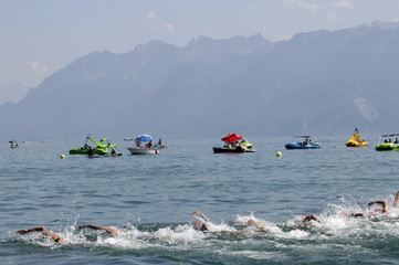 Athletes competes in the Lake Leman during the swimming stage of the ITU Women Sprint Triathlon World Championship in Lausanne