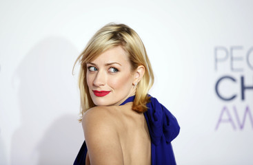 Beth Behrs arrives at the 2015 People's Choice Awards in Los Angeles