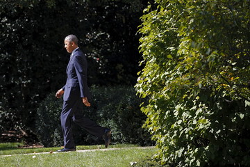 U.S. President Barack Obama walks on the South Lawn of the White House before his departure to Charleston, West Virginia, in Washington