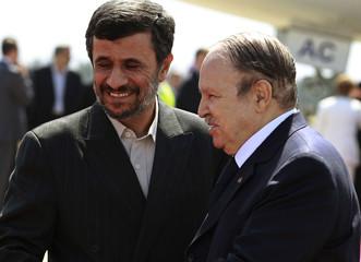Algeria's President Bouteflika welcomes his Iranian counterpart Ahmadinejad in Algiers