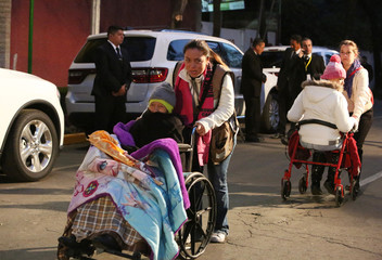 People arrive at the nunciature to wait for Pope Francis' departure in Mexico City