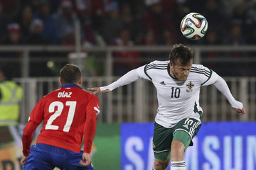 Samuel Clingan of Northern Ireland fights for the ball with Marcelo Diaz of Chile during their international friendly soccer match at Elias Figueroa stadium in Valparaiso