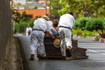 Toboggan riders on sledge in Monte - Funchal Madeira Portugal