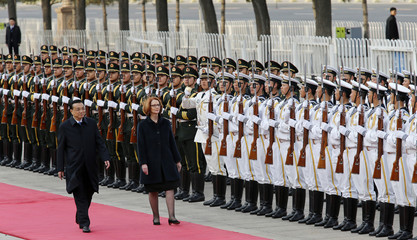 Australia's PM Julia Gillard inspects the guard of honour with Chinese Premier Li Keqiang during a welcome ceremony in Beijing