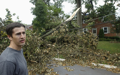 Cushman returns to his home to inspect exterior tree damage in Silver Spring, Maryland