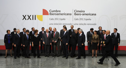 Spain's King Juan Carlos and Ibero-American leaders speak to each other after posing for a group photo during the Ibero-American Summit in Cadiz, southern Spain