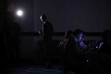 A network news reporter prepares to go on the air from the Faith & Freedom Coalition Road to Majority Conference in Washington