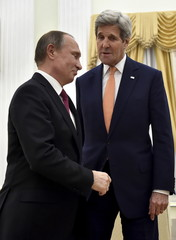 Russian President Vladimir Putin speaks with U.S. Secretary of State John Kerry during a meeting at the Kremlin in Moscow