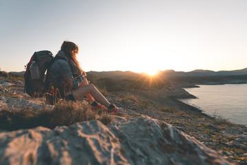 Woman enjoys Sunset over Cala Mitjana - Mallorca