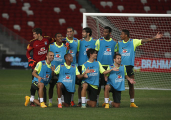 Brazil's national soccer team players pose for a photo during a training session ahead of their friendly soccer match against Japan at the National Stadium in Singapore