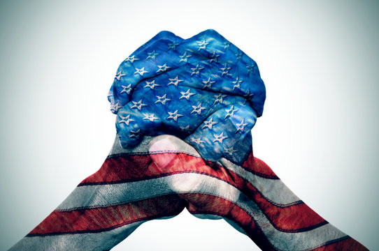 hands patterned with the US flag