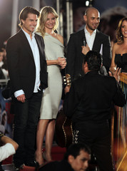 """U.S. actors Cruise and Diaz listen to a mariachi band play a birthday song for Cruise on the red carpet before the premiere of their film """"Knight & Day"""" in Mexico City"""