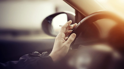 Smoking cigarettes while driving