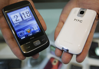 """Two HTC smartphones """"Smart"""" are displayed in a mobile phone store in Taipei"""