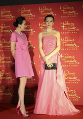 Hong Kong actress Lau looks at a wax figure of herself during an unveiling ceremony at a new Madame Tussauds Museum in Beijing