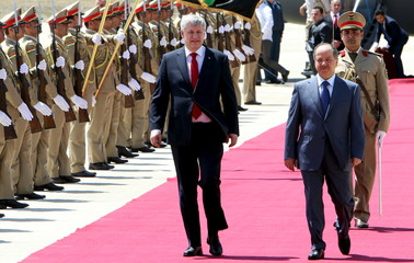 Canada's Prime Minister Harper and Iraq's Kurdish regional President Barzani walk during a welcoming ceremony after arriving at the airport in Erbil