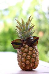 Pineapple with sunglasses, summer concept.