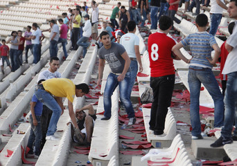 A Lebanese football fan lies wounded after clashes between fans during a Lebanon Football Championship match between Safa and Najmeh, in Sidon