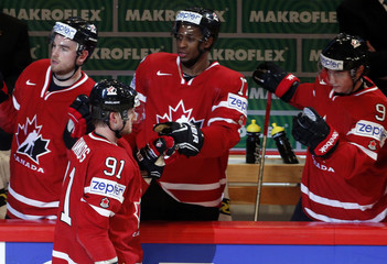 Canada's Stamkos celebrates his goal against Slovenia with his teammates on the bench during their 2013 IIHF Ice Hockey World Championship preliminary round match at the Globe Arena in Stockholm