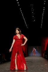Gail Simmons presents a creation during the American Heart Association's (AHA) Go Red For Women Red Dress Collection, presented by Macy's at New York Fashion Week.