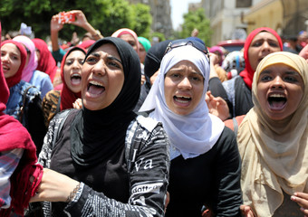 High school students take part in a protest against the cancellation and postponement of exams after a series of exam leaks, in front of the parliament in Cairo