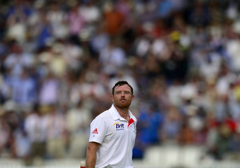 England's Bell walks off the field after being caught out for 74 runs during the third day of the second Ashes test match against Australia at Lords cricket ground in London