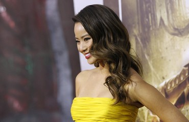 """Jamie Chung poses at the premiere of """"Sucker Punch"""" at the Grauman's Chinese theatre in Hollywood"""
