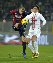 Juventus' Matri and Bologna's Casarini fight for the ball during their Italian Serie A soccer match in Turin