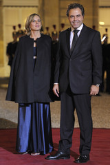 French Education Minister Chatel and his wife  arrive at the Elysee to attend a state dinner in Paris