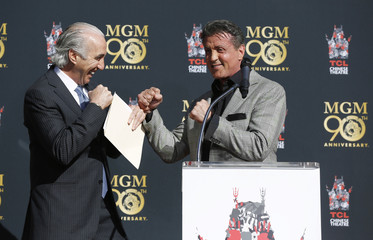 Stallone jokes with MGM CEO Barber at a paw print ceremony for MGM mascot Leo the Lion in the forecourt of the TCL Chinese theatre in Hollywood