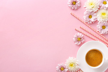 Flat lay flowers with a coffee cup. Pink pastel background. Copy space. Top view.
