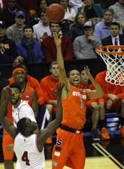 Syracuse Orange Carter-Williams shoots over Indiana Hoosiers Oladipo during the second half in their East Regional NCAA men's basketball game in Washington