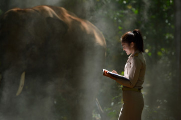 Beautiful woman and elephant with Thai teacher ,vintage style