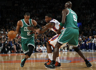 Boston Celtics' Rondo breaks free from New York Knicks' Shumpert as Celtics' Kevin Garnett tries to block Shumpert with a pick in the second quarter during their NBA basketball game in New York