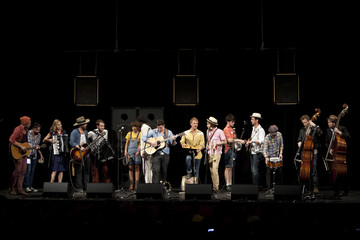 Members of Mumford & Sons, Edward Sharpe and the Magnetic Zeroes, and the Old Crow Medicine Show share the stage during a performance at the Paramount Theater in Austin.