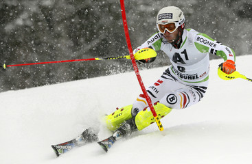 Dopfer of Germany clears a gate during the men's slalom race at the FIS Alpine Skiing World Cup in Kitzbuehel