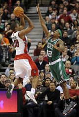 Raptors' DeRozan tries to get a shot over Celtics' Brown during their pre-season NBA basketball game in Toronto