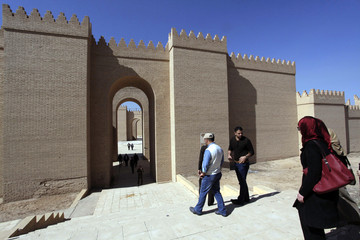 Visitors enter the ancient city of Babylon near Hilla