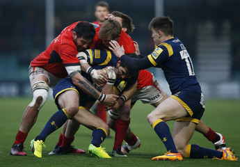 Worcester's Wynand Olivier is tackled by the Saracens' defence