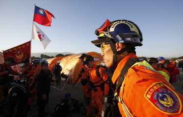 A member of Taiwan's Taipei Urban Search and rescue team prepares for today's deployment at the UN compound at the Port-au-Prince airport