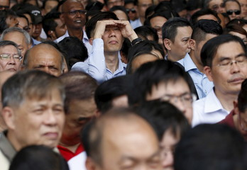 People attend a lunchtime election rally by the opposition Singapore Democratic Party (SDP) at the central business district in Singapore