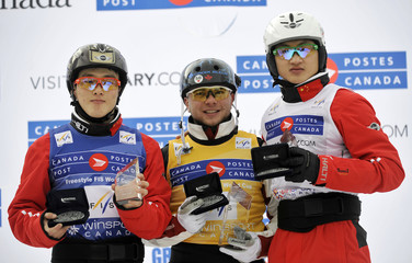 Rochon of Canda, Qi and Liu of China pose with their medals at the World Cup Freestyle Aerials finals in Calgary