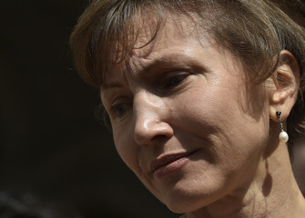 Marina Litvinenko, the wife of former KGB agent Alexander Litvinenko who was murdered in London, speaks outside the Royal Courts of Justice in London