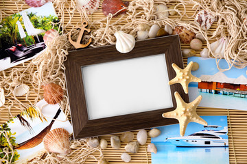 Travel concept. Composition with photo frame on bamboo mat background