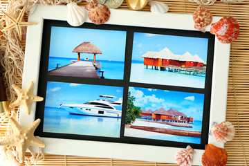 Travel concept. Composition with photos on bamboo mat background