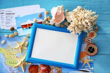 Travel concept. Composition with photo frame on wooden background