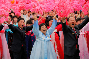 People react as they see North Korean leader Kim Jong-un during a mass rally and parade in Pyongyang