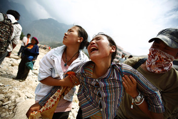 A woman mourns her missing relatives in the landslide-hit Zhouqu County of Gannan Tibetan Autonomous Prefecture